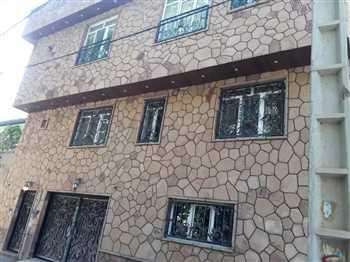اجرای نمای ساختمان با سنگ لاشه ای ورقه ای اجرا بصورت فرزی و تیشهء توسط پیمانکاری رحمانی و رشیدی